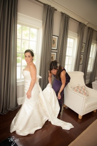 Mother of the bride, helping her get dressed.  Super special time for mother and daughter!
